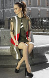Street portrait of a woman, model. Girl sitting on the bench stock images