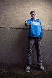 Street portrait of young boy in blue sweatshirt with modern eyeg Royalty Free Stock Image