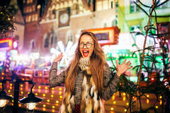 Street portrait of young woman  on the festive Christma Royalty Free Stock Image