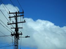 Street Power Lines Hub. Against a cloudy blue sky background Royalty Free Stock Images