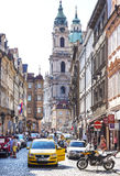 Street of Prague crowded with tourists and vehicle Royalty Free Stock Images