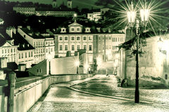 The street in Prague in the light of lanterns. Vintage view. Stock Photo