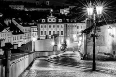 The street in Prague in the light of lanterns. Vintage view. Stock Image