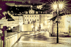 The street in Prague in the light of lanterns. Vintage view. Stock Photography