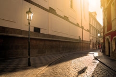 Street in Prague at sunset. A sunlit street in Prague Stock Image