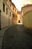 Street in Prague at sunset. A sunlit street in Prague Stock Images