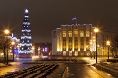 Street proletarian dictatorship. Christmas tree and the building of the Leningrad Region. St. Petersburg. Stock Photography