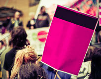 Street Protesters With Blank Sign. Busy Street Protest March With A Blank Sign For Your Text stock image