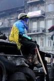 Ukraine, Kiev. Street protests in Kiev, a barricade with revolutionaries. Street protests in Kiev, a barricade with revolutionaries. A rebel with a baton in the royalty free stock photos
