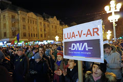 Street protests in Romania. DNA banner. 20.000 people demonstrate and protest against controversial decrees to pardon corrupt politicians and decriminalize Stock Image