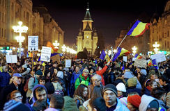 Street protests in Romania. Timisoara. 20.000 people demonstrate and protest against controversial decrees to pardon corrupt politicians and decriminalize Stock Photos