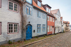 Street prspective of Flensburg, Germany. Street prspective with traditional colorful living houses along the street in old Flensburg, Germany Royalty Free Stock Image