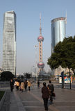 Street in Pudong, Shanghai. Street scene in Pudong. Oriental Pearl Tower in the background. Photo taken at 18th of November 2010 Royalty Free Stock Images