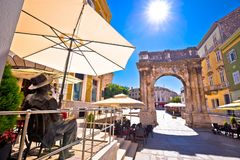 Street of Pula with historic Roman Golden gate and James Joyce s Stock Image