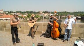 Street quartet. Prague, Czech Republic - 12, June, 2015.The quartet of male street musicians playing the saxophone, kontrobase, oboe and guitar Royalty Free Stock Images