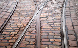 Street railway point on cobblestone road Royalty Free Stock Images