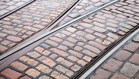 Street railway point on cobblestone road Stock Photography