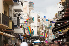 Street with rainbow flags  in Sitges Royalty Free Stock Photos