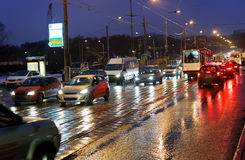Street in rainy evening in Moscow Stock Images