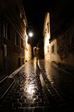 Street on a rainy night. A street in the old center of Brasov, Romania, on a rainy night Stock Image
