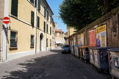 Street of Ravenna, Italy with selective waste bins royalty free stock photo