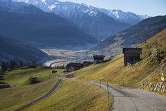 Street reaching into the frozen valley, Pass Thurn. Tirol, Austria Royalty Free Stock Photography