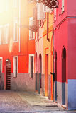 Street with red houses Stock Photos