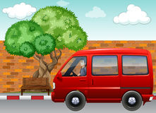 Street. Red van parking on a street near a bench and a tree royalty free illustration