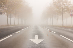 Street with reduced visibility due to fog royalty free stock photos