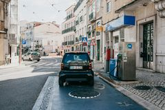 Street refueling of vehicles with gasoline in Lisbon. The car drove up to refuel gasoline for further travel. Portugal, Lisbon, 01 May 2018: Street refueling of stock photos