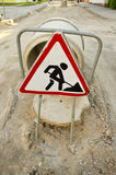 Street repair works and road sign Royalty Free Stock Photography