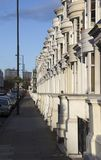 London Houses. Street with residential houses and parked cars in London, Bayeswater district Stock Photos