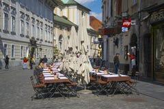 Street restaurant in the center of Ljubljana, Slovenia. LJUBLJANA, SLOVENIA - APRIL 20, 2016: Street restaurant in the center of Ljubljana city, Slovenia on Stock Image