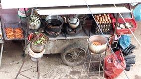 Street restaurant in center Phnom Penh. Asian food on the street, Cambodia stock footage