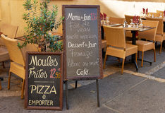 Street restaurant in France. Menu and tables of street restaurant in Aix en Provence town, PACA, France Stock Photography