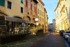 Street and restaurant, outdoors, in Conegliano city Stock Image