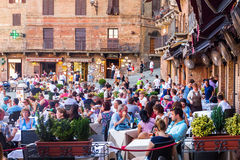 Street restaurants on Piazza del Campo in Siena Stock Images