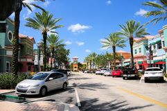 Street with retail stores & parked cars, South FL Stock Photo