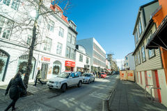 Street in Reykjavik with cars and shops Stock Photo