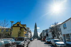 Street in Reykjavik with the Hallgrimskirkja at the end. REYKJAVIK, ICELAND - APRIL 7 - 2016: Street in Reykjavik with the Hallgrimskirkja at the end stock image