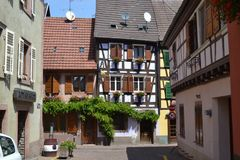 The street of Ribeauvillé village. Wine road of Alsace. Eastern France. Alsace region. A beautiful village named Ribeauville on the famose Wine road. It has Royalty Free Stock Photo