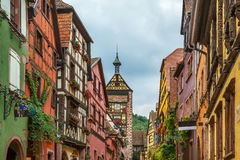 Street in Riquewihr, Alsace, France. Main street with historical houses in Riquewihr, Alsace, France Royalty Free Stock Images