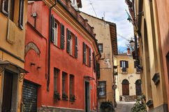 Street in Rivoli. Northern Italy with colorful painted houses Stock Photography
