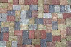 Street road stone paving of multicolor bricks. Background of street road colorful stone paving of multicolor bricks, close up, top view, high angle, directly Royalty Free Stock Images