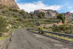 Street with curve in Gran Canaria with road sign. Street or roadway with curve in Gran Canaria with double curve road sign Stock Image