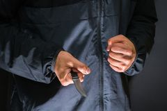 Street robber with a knife - killer person with sharp knife abou. T to commit a homicide, murder scenery stock photos
