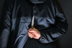 Street robber with a knife - killer person with sharp knife about to commit a homicide, murder scenery royalty free stock photo