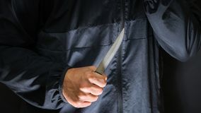Street robber with a knife - killer person with sharp knife abou. T to commit a homicide, murder scenery stock photo