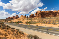 Street through rock formations, Arches National Park, USA Royalty Free Stock Image