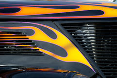 Street Rod 12. Details of the hood and grill on a customized vehicle Royalty Free Stock Photos